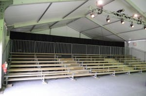 American Pavilion clearspan tent with bleachers for a corporate presentation. Losberger, tent bleachers, rental lighting