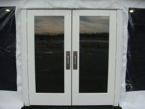 Double entry glass doors for clear span tent