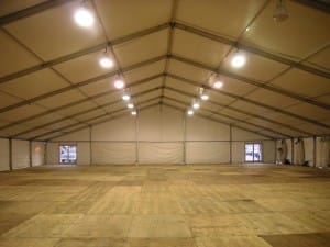 large clear span tent with floor installed as sleeping tents for huricane first responders